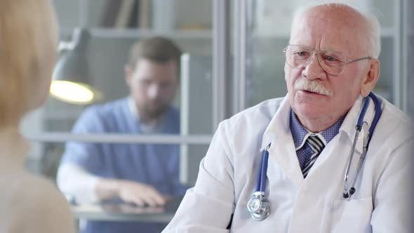 Thumbnail for Senior Doctor Giving Consultation to Woman