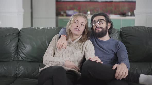 Thumbnail for Happy Caucasian Couple Sitting on Couch at Home and Discussing Renovation Works