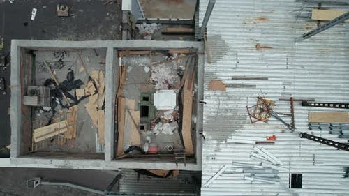 Top Aerial View of a Construction Site on the Roof of a Tall Building