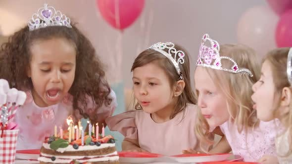 Thumbnail for Little Cuties Blowing Candles on Birthday Cake