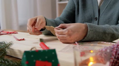 Hands Making Advent Calender on Christmas at Home