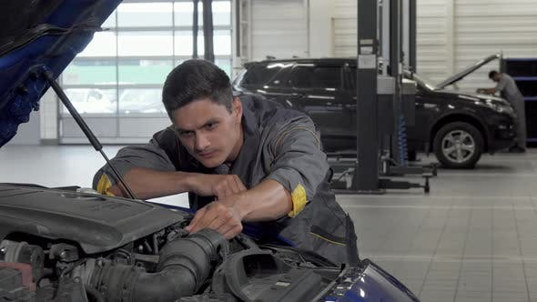 Thumbnail for Auto Mechanic Looking Under the Hood of a Car at the Garage