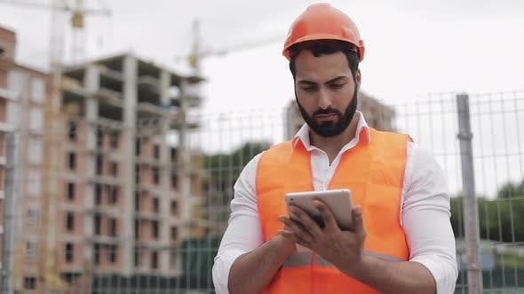 Thumbnail for Architect Man Standing with Tablet on the Construction Site and Analyzing Scheme Project Plan