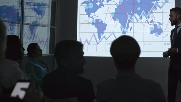 Thumbnail for Young Businessman Explaining Statistics