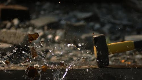 Glass bottle smashed in ultra slow motion