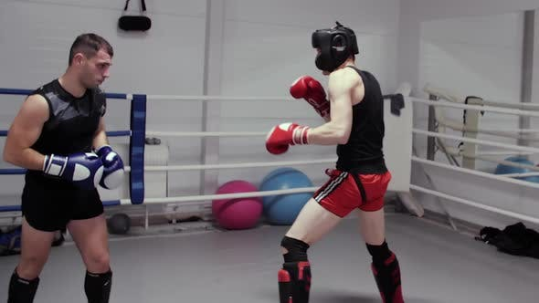 Two Boxers Training High Kick on Ring in Fight Club