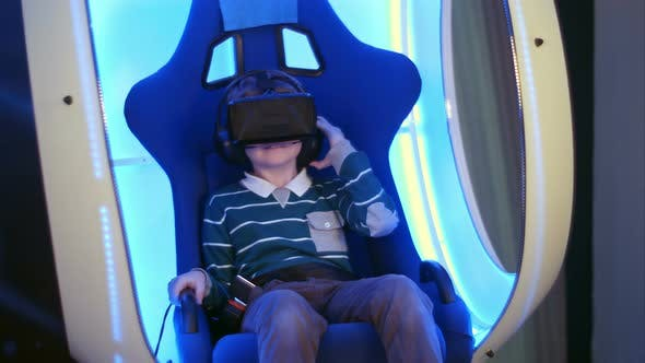 Thumbnail for Surprised Little Boy Experiencing Virtual Reality in a Moving Interactive Chair