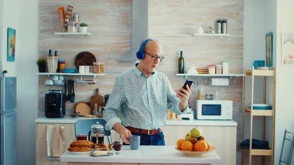 Thumbnail for Senior Man Wearing Headphones
