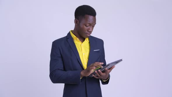 Thumbnail for Young Happy African Businessman Using Digital Tablet and Getting Good News