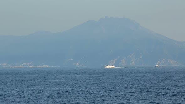 Cruise liner sailing near amazing Vesuvius mount, water transportation, tourism