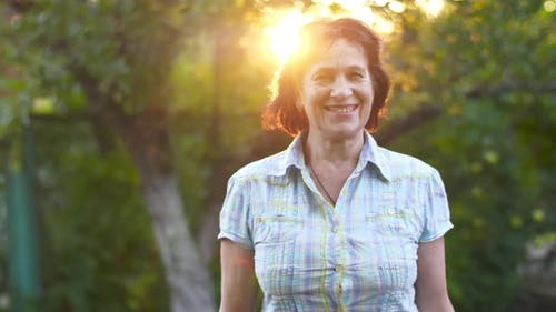Smiling Mature Woman on Sunset