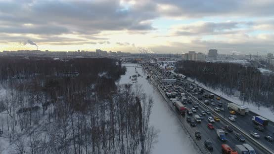 Cover Image for Cars Traffic on Highway at Sunny Winter Morning in the City. Aerial View
