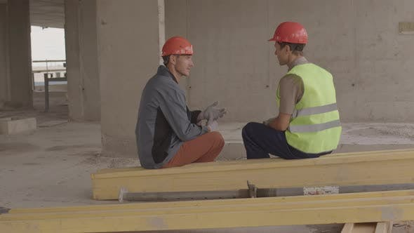 Builders Sitting in Premises under Construction