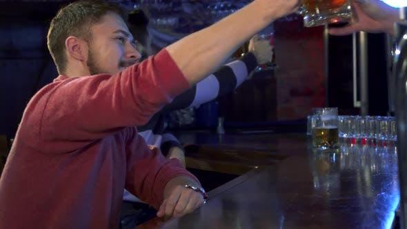 Thumbnail for Man Tastes Beer at the Pub