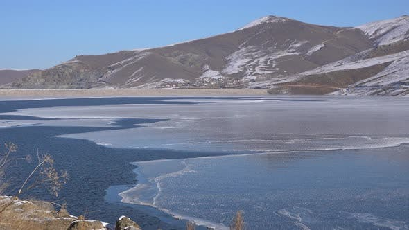Thumbnail for Frozen Water Surface Floe of Dam Lake Melts in Spring