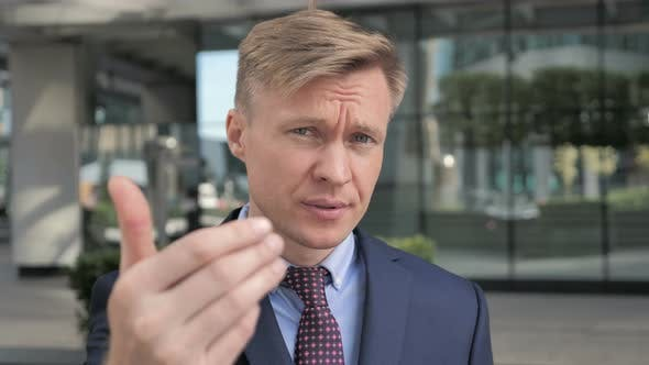 Thumbnail for Inviting Gesture by Businessman