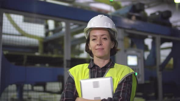 Thumbnail for Caucasian Female Engineer Posing in front of Industrial Machine at Factory