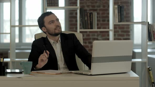 Thumbnail for Young Businessman Sitting in Office, Search Idea