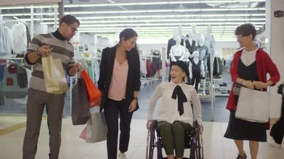 Woman with Disability Shopping in Mall with Friends