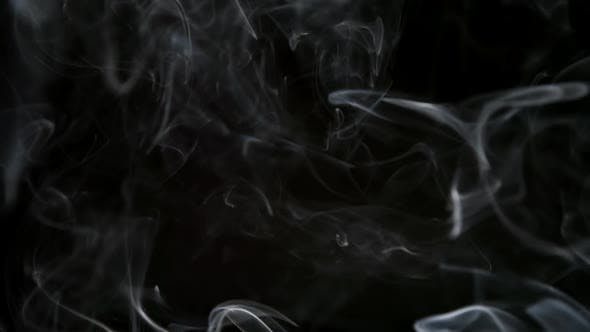 Thumbnail for Thin Smoke Lifts Up On A Dark Background