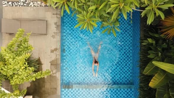 Girl is Swimming in the Pool