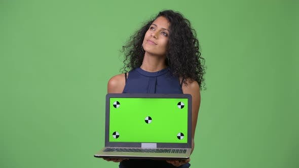 Thumbnail for Young Beautiful Hispanic Businesswoman Showing Laptop