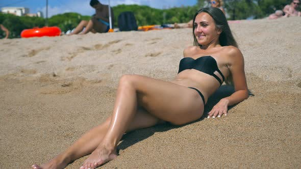 Thumbnail for Young Girl in Bikini Lying on Sea Beach and Sunbathing. Beautiful Caucasian Woman Relaxing on Ocean