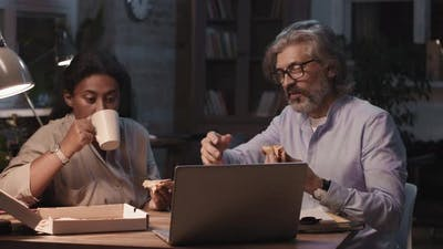 Coworkers Working Late In Office