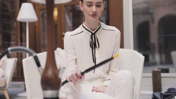 Fruit Hookah. Atractive Woman Smoking Shisha At Bar