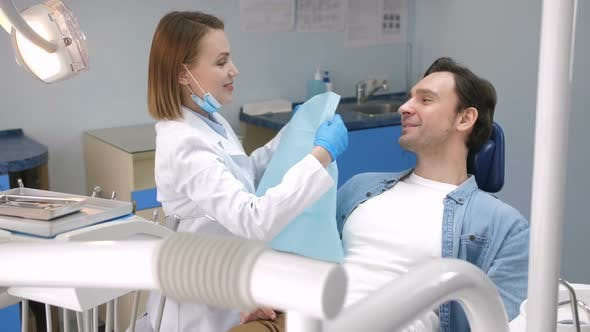 Thumbnail for Happy Male Patient Smiling After Dental Treatment