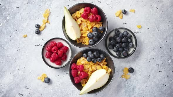 Thumbnail for Golden Cornflakes with Fresh Fruits of Raspberries, Blueberries and Pear in Ceramic Bowl