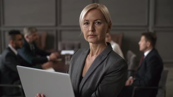 Thumbnail for Caucasian Female Executive with Laptop Posing during Business Meeting