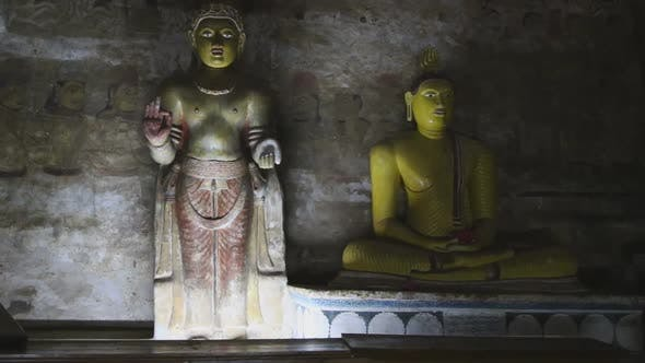 Thumbnail for DAMBULLA, SRI LANKA - FEBRUARY 2014: Sitting Buddha and standing Buddha at the Golden Temple of Damb