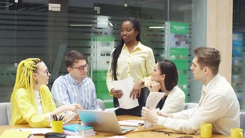 African Leader Giving Recommendation To Her Employees