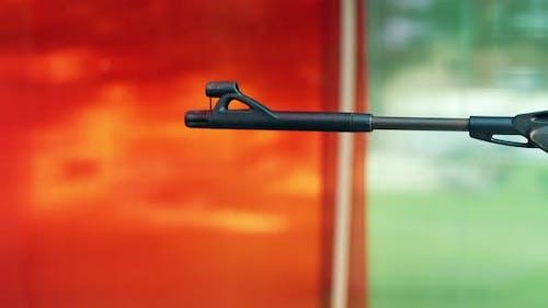 Closeup Somebody Shoots a Shooting Dash From a Pneumatic Gun