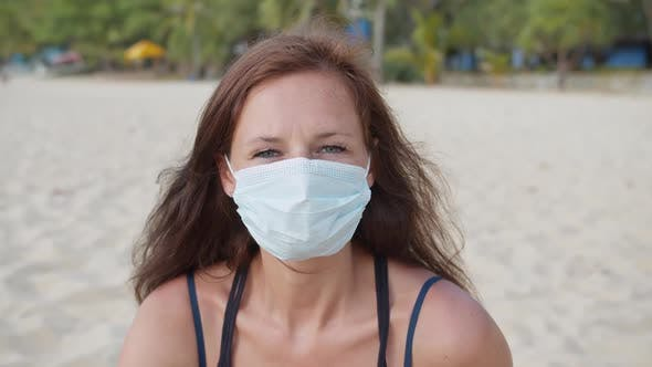Thumbnail for a Woman Wearing a Medical Mask on the Beach