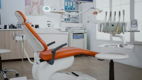 Interior of Modern Equipped Dental Orthodontic Office with Teeth x Ray Images