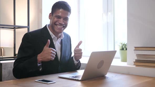 Thumbnail for Thumbs Up by Black Businessman while Working on Laptop