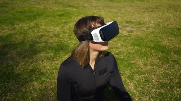 Thumbnail for Young Woman in Sportswear Using Virtual Reality Headset in Park