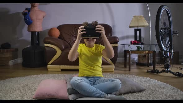 Thumbnail for Portrait of Smiling Caucasian Boy in Casual Clothes Taking on VR Headset. Cute Child Trying on His
