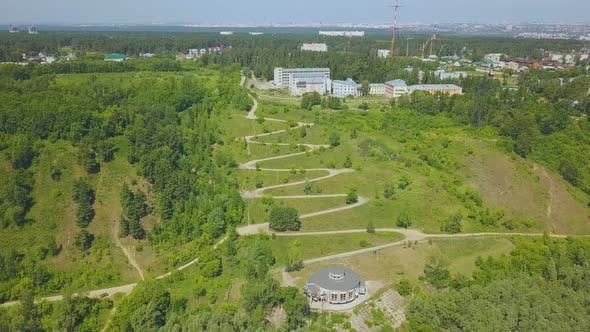Thumbnail for Green Hill with Path on Hairpin Curves on Nice Day Aerial