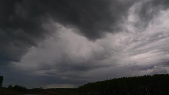 Thumbnail for Dark Storm Clouds Over Forest, Timelapse