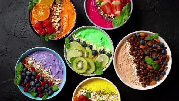 Thumbnail for Various Healthy Fresh Smoothies or Yogurts in Bowls. With Strawberries, Kiwi, Chia, Blackberries