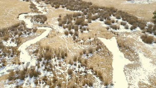 Aerial view of small mountain creek  in the Winter.