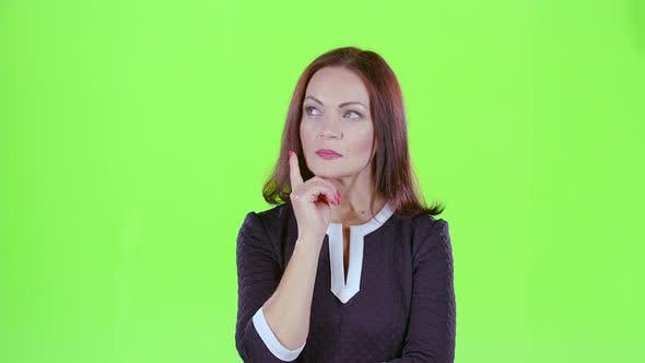 Thumbnail for Woman Thinks and She Has an Idea in Her Head. Green Screen
