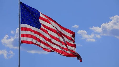 The flag of the United States of American blowing in the wind