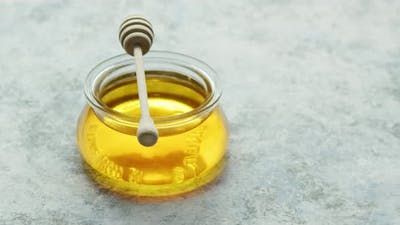 Glass Bowl of Honey on Table