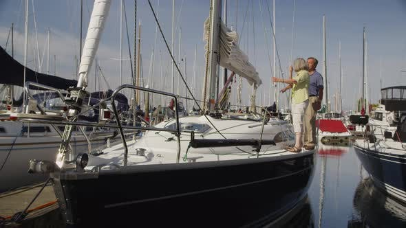Thumbnail for Senior couple on sailboat together. Shot on RED EPIC for high quality 4K, UHD, Ultra HD resolution.