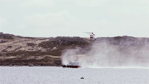 Cover Image for Coastguard Helicopter Flies over a Coastguard Ship.