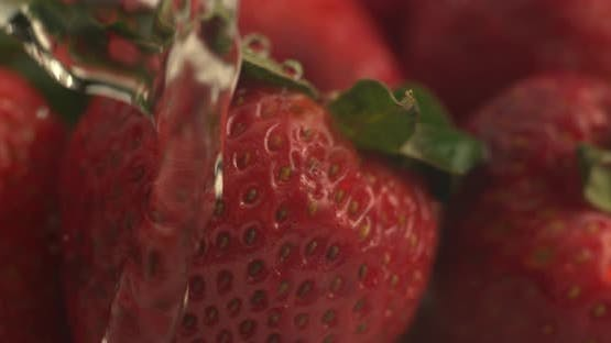 Water dripping onto strawberries in super slow motion.  Shot on Phantom Flex 4K high speed camera.